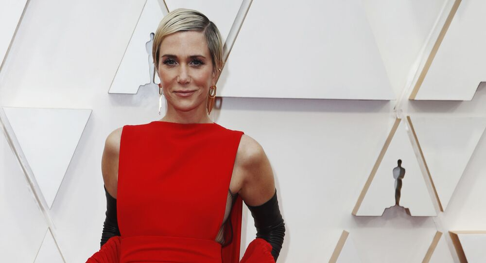 Kristen Wiig in Valentino poses on the red carpet during the Oscars arrivals at the 92nd Academy Awards in Hollywood, Los Angeles, California, U.S., February 9, 2020