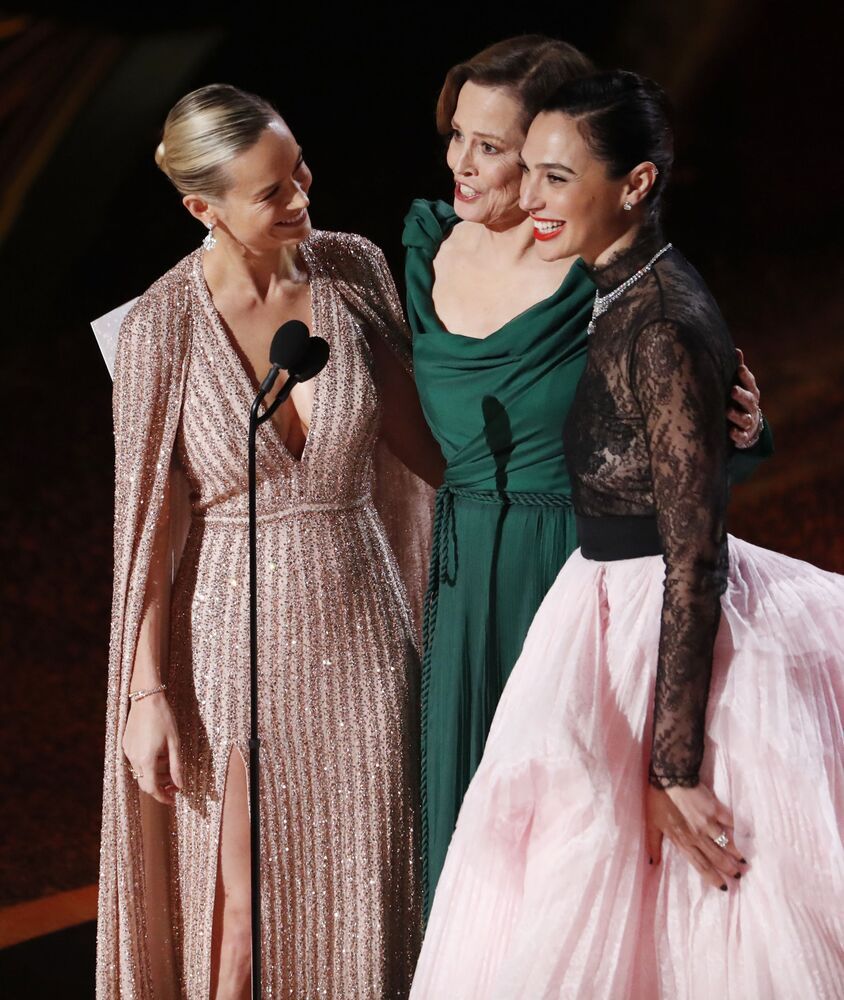 Brie Larson, Sigourney Weaver, and Gal Gadot present the Best Original Score nominations performance by Eimear Noone, the first woman to conduct the orchestra at an Oscars ceremony, at the 92nd Academy Awards in Hollywood, Los Angeles, California on 9 February 2020.