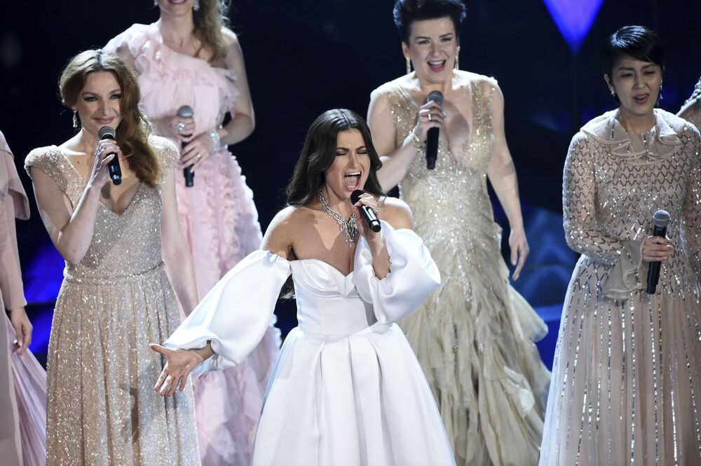 Idina Menzel, centre, performs with international voice actresses that play Elsa in the movie Frozen II at the Oscars on Sunday, 9 February 2020 at the Dolby Theatre in Los Angeles.