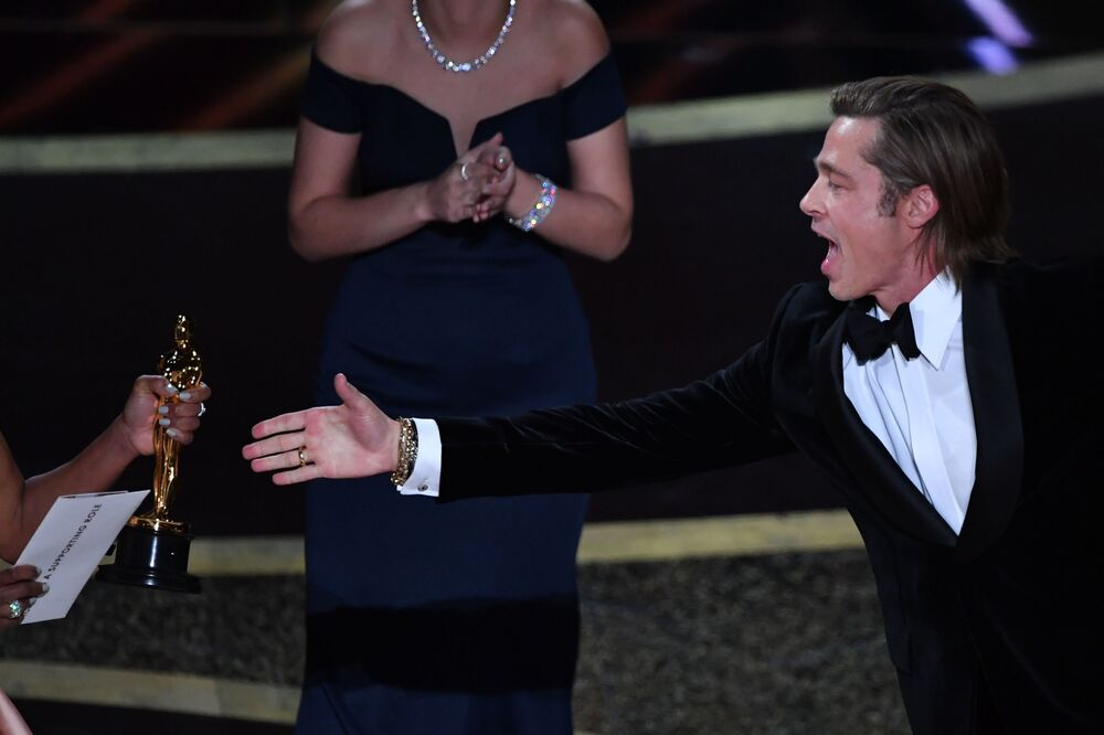 US actor Brad Pitt accepts the award for best actor in a supporting role for Once Upon a Time...in Hollywood from US actress Regina King (L) during the 92nd Oscars at the Dolby Theatre in Hollywood, California on 9 February 2020.