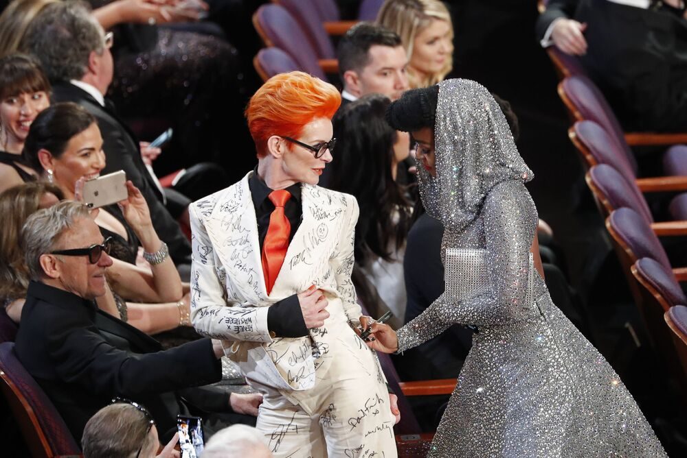 Janelle Monae signs Sandy Powell's outfit during the Oscars show at the 92nd Academy Awards in Hollywood, Los Angeles, California on 9 February 2020.