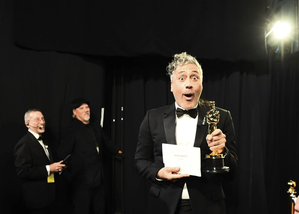 In this photo provided by A.M.P.A.S., Best Adapted Screenplay winner Taika Waititi walks backstage during the 92nd Oscars at the Dolby Theatre in Hollywood, California on 9 February 2020.