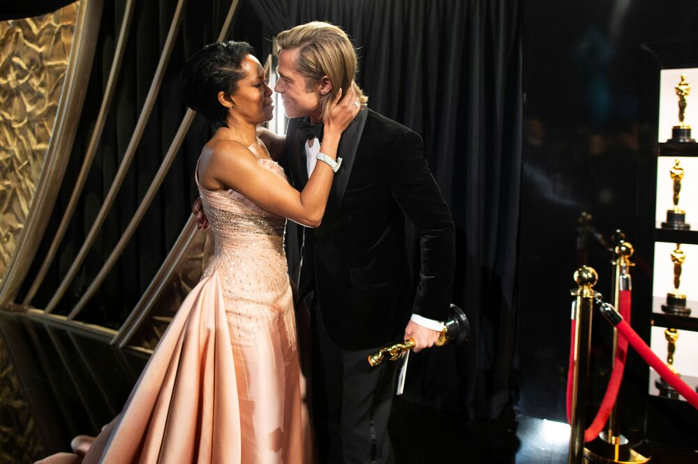 Best Supporting Actor Brad Pitt embraces Regina King as he holds his Oscar at the 92nd Academy Awards in Hollywood, Los Angeles, California on 9 February 2020.