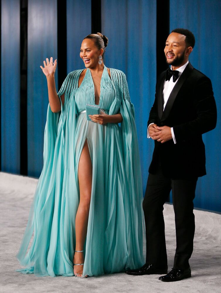 Model Chrissy Teigan and singer John Legend attend the Vanity Fair Oscar party in Beverly Hills following the 92nd Academy Awards, in Los Angeles, California on 9 February 2020.