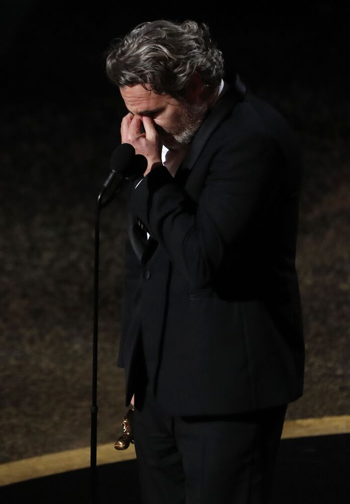 Joaquin Phoenix reacts as he accepts the Oscar for Best Actor for Joker at the 92nd Academy Awards in Hollywood, Los Angeles, California on 9 February 2020.