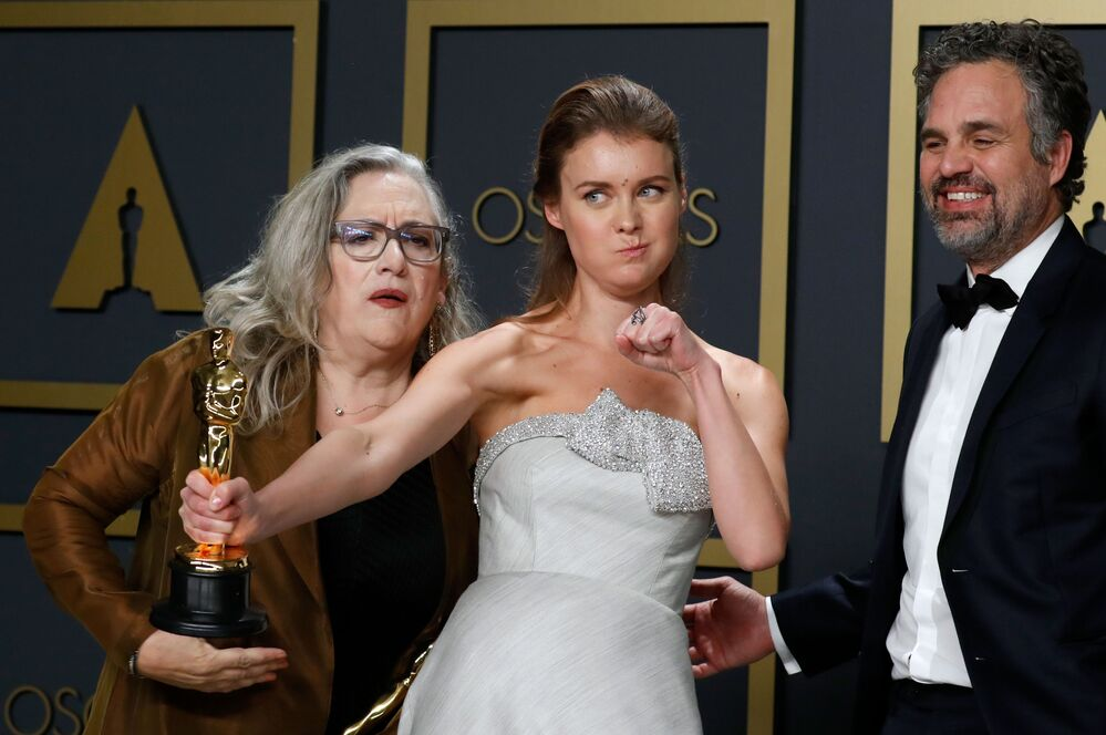 Carol Dysinger and Elena Andreicheva pose with the Oscar for Best Documentary Short Subject for Learning to Skateboard in a Warzone (If You're a Girl) with presenter Mark Ruffalo in the photo room at the 92nd Academy Awards in Hollywood, Los Angeles, California on 9 February 2020.