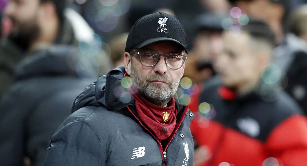 Liverpool's manager Jurgen Klopp looks on before the English Premier League soccer match between West Ham Utd and Liverpool at the London Stadium in London, Wednesday, Jan. 29, 2020
