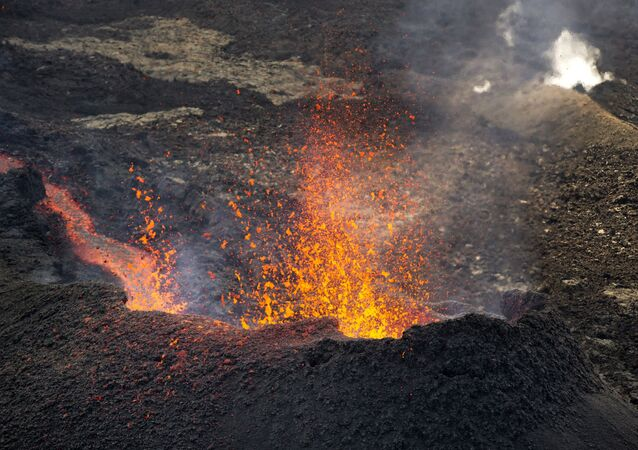 Lava erupts from the Piton de la Fournaise Peak of the Furnace volcano, on the southeastern corner of the Indian Ocean island of Reunion Saturday, Aug. 1, 2015