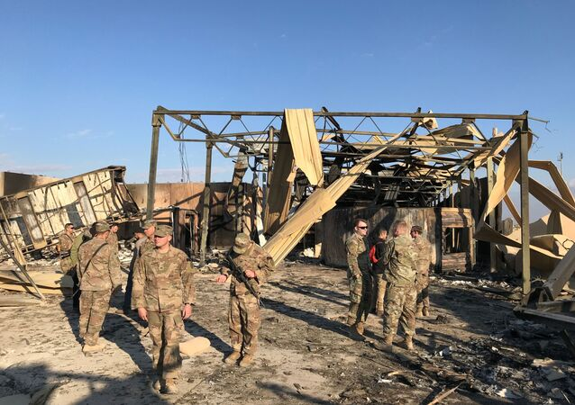 U.S. soldiers inspect the site where an Iranian missile hit at Ain al-Asad air base in Anbar province, Iraq