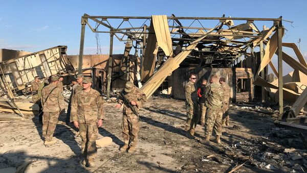 U.S. soldiers inspect the site where an Iranian missile hit at Ain al-Asad air base in Anbar province, Iraq - Sputnik International