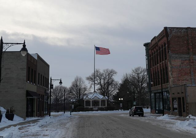 An American flag waves from a pole down a street in Fort Dodge, Iowa