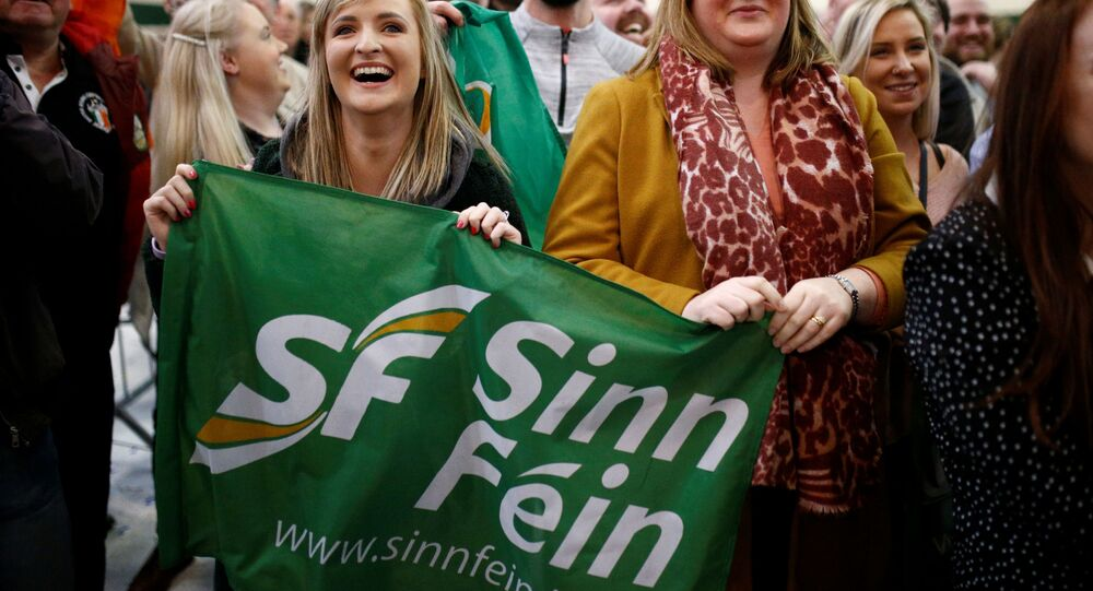 Sinn Fein supporters react after exit polls were announced in Ireland's national election
