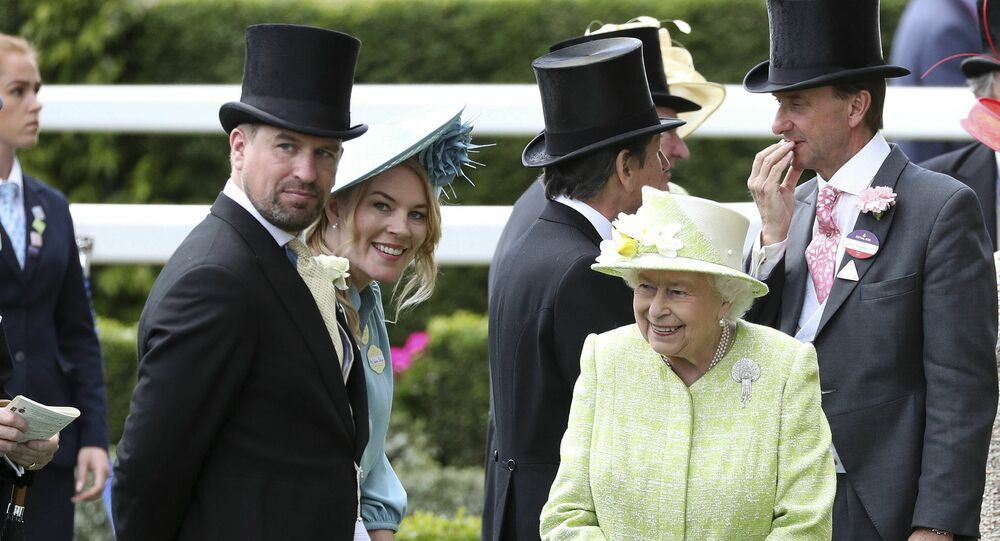 Britain's Queen Elizabeth II right talks to her grandson, Peter Phillips, left and his wife Autumn, during day five of Royal Ascot in Ascot, England, Saturday June 22, 2019