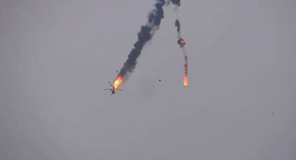 The video shows dramatic footage of the helicopter in flames going down in Idlib