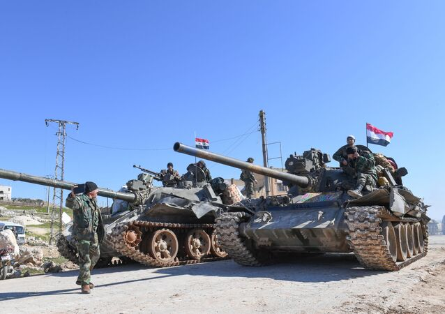 Syrian army units advance in the town of al-Eis in south Aleppo province on February 9, 2020, following battles with rebels and jihadists