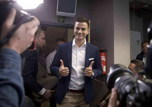 Far-right frontman and founder of Schild en Vrienden, Dries Van Langenhove gives the thumbs up as he arrives for a media conference of the far right Vlaams Belang Party in Brussels, Monday, May 27, 2019