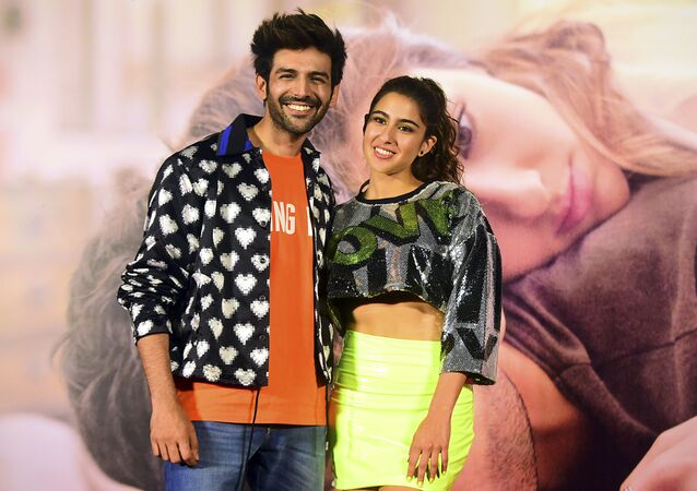 Bollywood actors Kartik Aaryan (L) and Sara Ali Khan (R) pose for photographs during the trailer launch of the upcoming romantic drama Hindi film 'Love Aaj Kal' in Mumbai on January 17, 2020