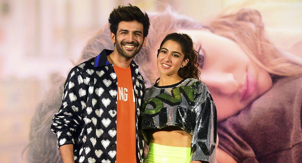 Bollywood actors Kartik Aaryan (L) and Sara Ali Khan (R) pose for photographs during the trailer launch of the upcoming romantic drama Hindi film 'Love Aaj Kal' in Mumbai on January 17, 2020