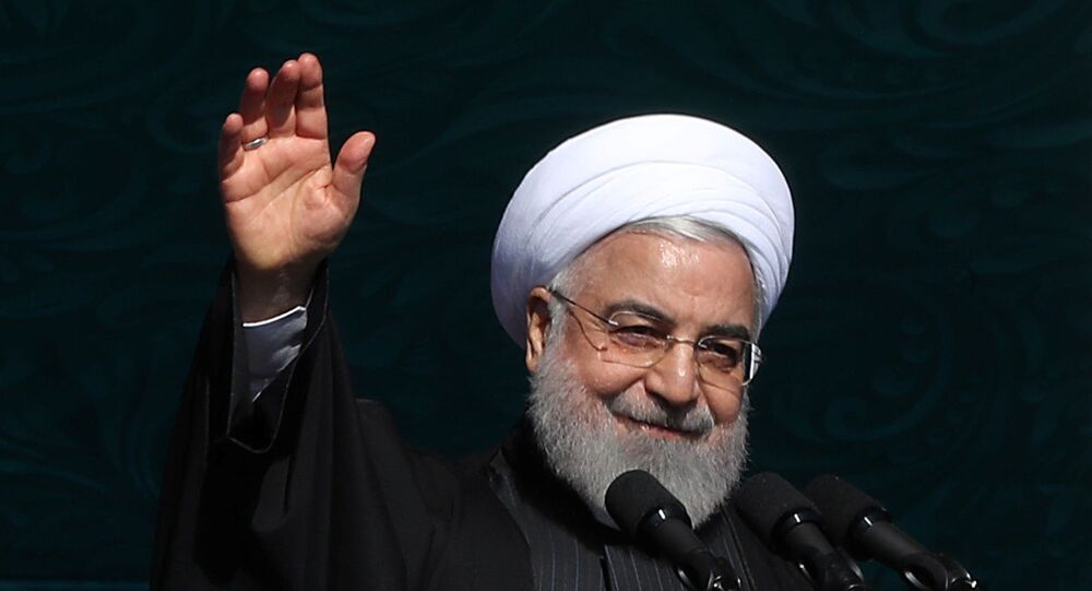 Iranian President Hassan Rouhani salutes the crowd during the commemoration of the 41st anniversary of the Islamic revolution in Tehran, Iran February 11, 2020.