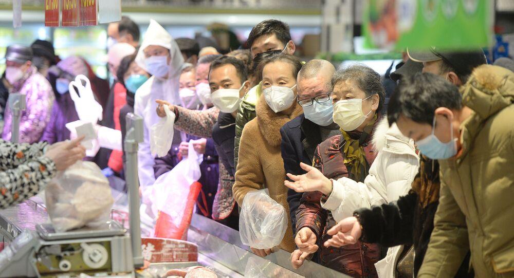 Customers wearing face masks shop inside a supermarket following an outbreak of the novel coronavirus in Wuhan