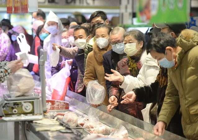Customers wearing face masks shop inside a supermarket following an outbreak of the novel coronavirus in Wuhan
