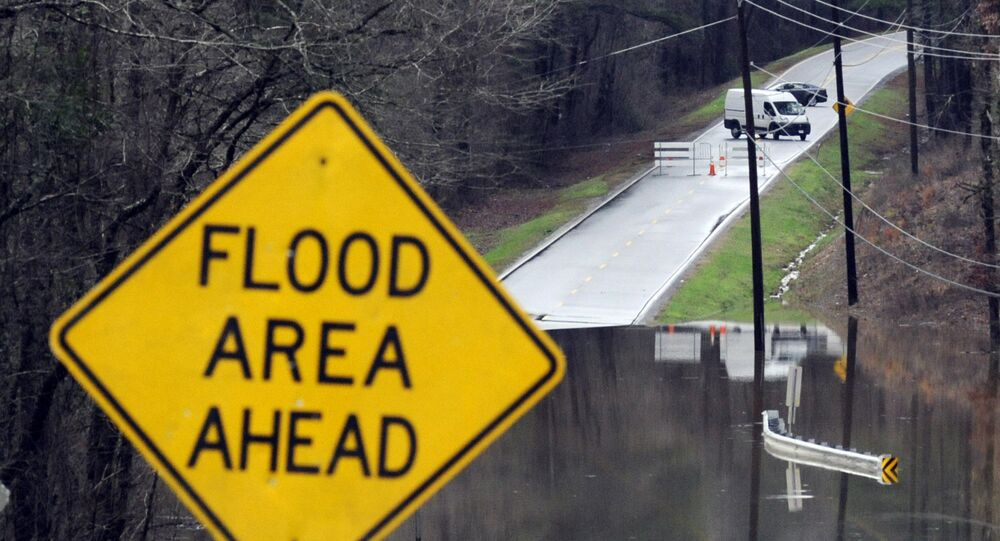 Vehicles turn around on a road blocked by floodwaters in Helena, Ala., on Tuesday, Feb. 11, 2020. The National Weather Service said flooding was expected from central Mississippi to north Georgia following downpours, and severe storms could follow the rain. (AP Photo/Jay Reeves)