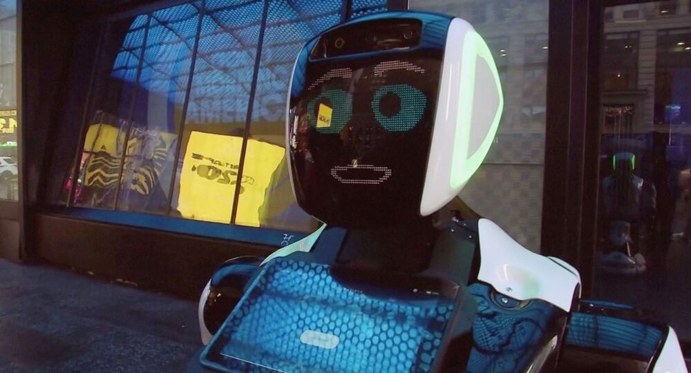 A Promobot robot that informs the public about the symptoms of coronavirus and how to prevent it from spreading, stands in Times Square in this still frame obtained from video, in New York City, U.S.  February 10, 2020.