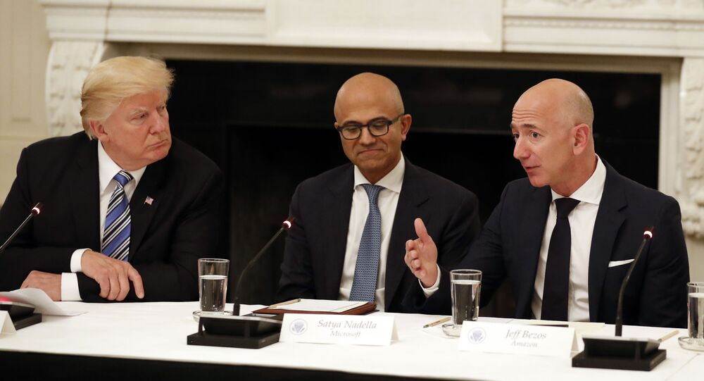 FILE - In this June 19, 2017, file photo, President Donald Trump, from left, and Satya Nadella, Chief Executive Officer of Microsoft, listen as Jeff Bezos, Chief Executive Officer of Amazon, speaks during an American Technology Council roundtable in the State Dinning Room of the White House in Washington