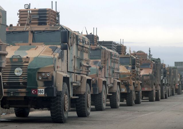 Turkish military vehicles are seen in Hazano near Idlib, Syria, February 11, 2020