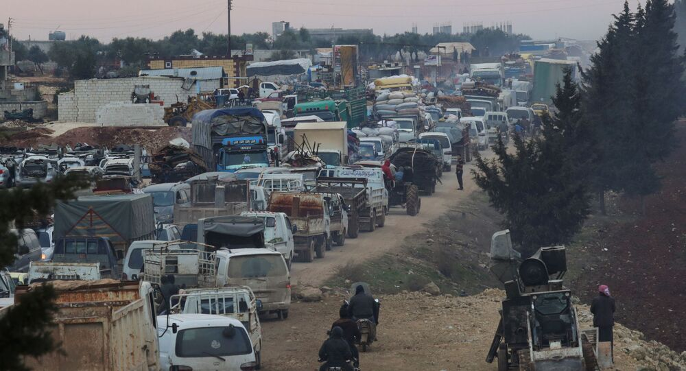 A general view of trucks carrying belongings of displaced Syrians, is pictured in the town of Sarmada in Idlib province, Syria, January 28, 2020