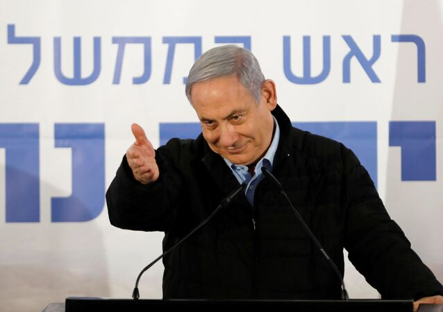 Israeli Prime Minister Benjamin Netanyahu gestures as he speaks during an event marking Tu BiShvat, the Jewish Arbor Day, in the Israeli settlement of Mevo'ot Yericho, in the Israeli-occupied West Bank February 10, 2020