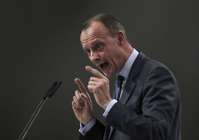Friedrich Merz delivers his speech when running for chairman at the party convention of the Christian Democratic Party CDU in Hamburg, Germany, Friday, Dec. 7, 2018