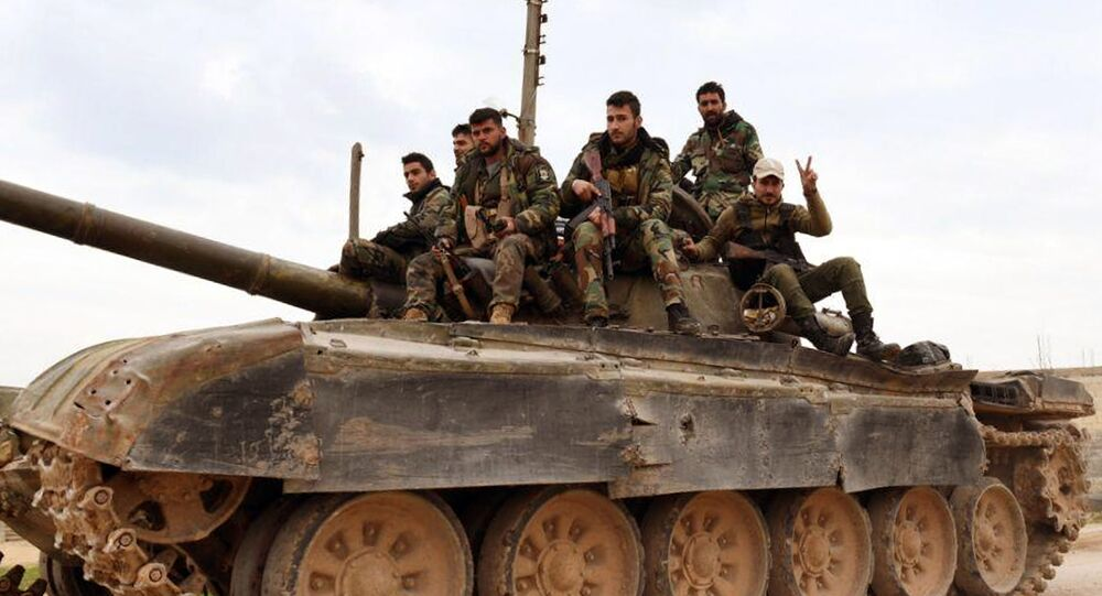 Syrian government forces entering the village of Tel-Toukan, in Idlib province
