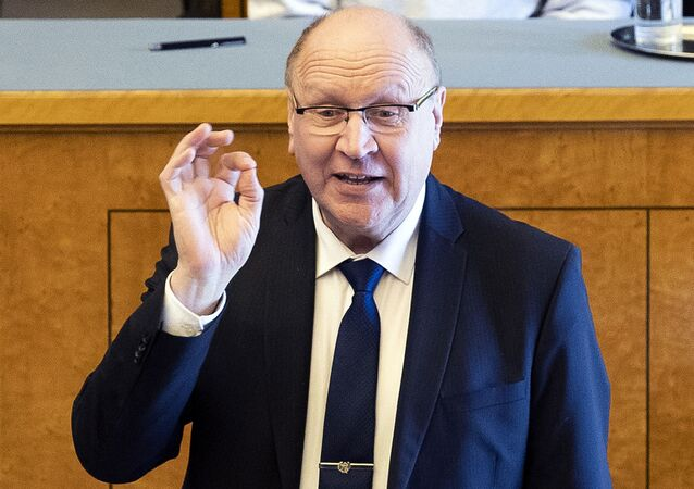 Mart Helme gestures while speaking during the presentation of the new government in Tallinn, Estonia.