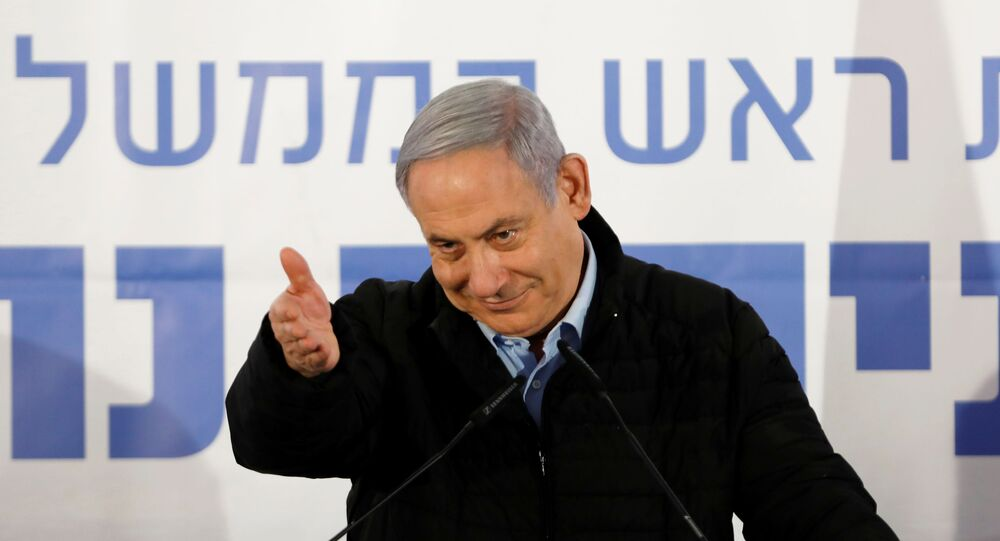 Israeli Prime Minister Benjamin Netanyahu gestures as he speaks during an event marking Tu BiShvat, the Jewish Arbor Day, in the Israeli settlement of Mevo'ot Yericho, in the Israeli-occupied West Bank February 10, 2020.