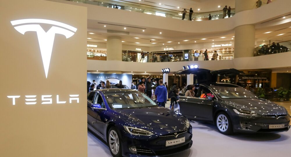 A Tesla Model S and Model X are displayed at a shopping mall in Hong Kong