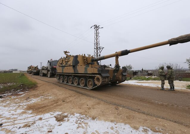Turkish military convoy is seen near the town of Idlib, Syria, Wednesday, Feb. 12, 2020