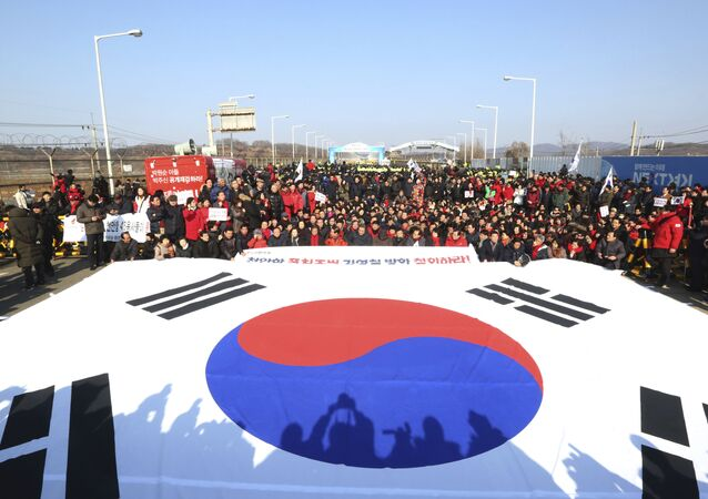 Members of the main opposition the Liberty Korea Party stage a rally against a visit of Kim Yong Chol, vice chairman of North Korea's ruling Workers' Party Central Committee, near the Unification bridge in Paju, South Korea, Sunday, Feb. 25, 2018