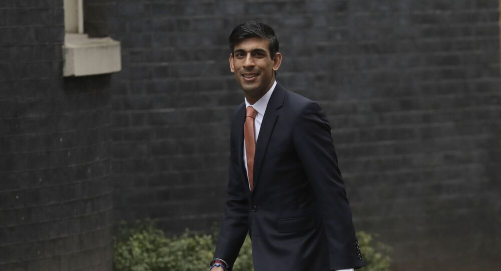 Rishi Sunak, the newly appointed Chancellor of the Exchequer, arrives at 10 Downing Street to meet Boris Johnson
