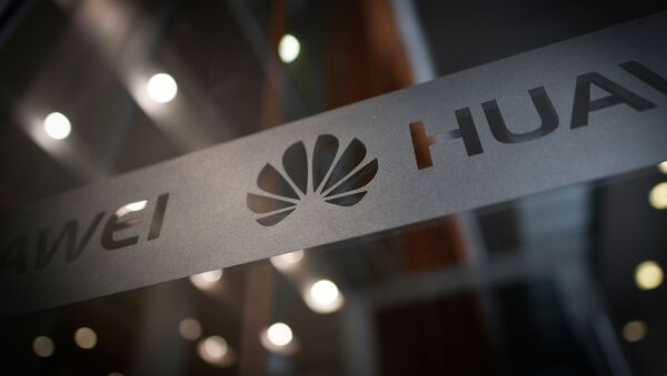A Huawei logo is seen at a Huawei production base during a media tour in Donggguan, China's Guangdong province on March 6, 2019 - Sputnik International