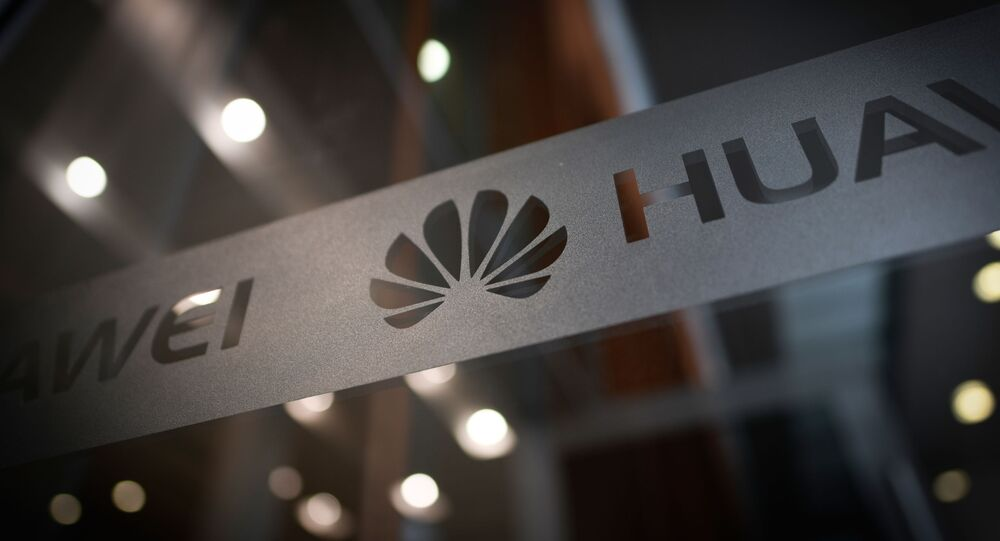 A Huawei logo is seen at a Huawei production base during a media tour in Donggguan, China's Guangdong province on March 6, 2019