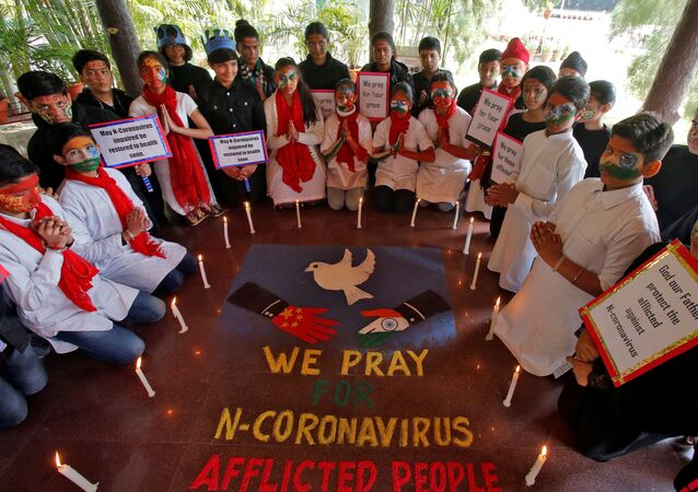 Students pray for the victims of coronavirus at a school in Chandigarh, India, January 31, 2020