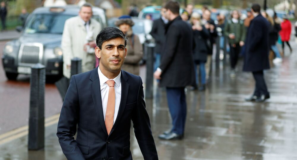 Newly appointed Britain's Chancellor of the Exchequer Rishi Sunak arrives at the Treasury in London, Britain, February 13, 2020