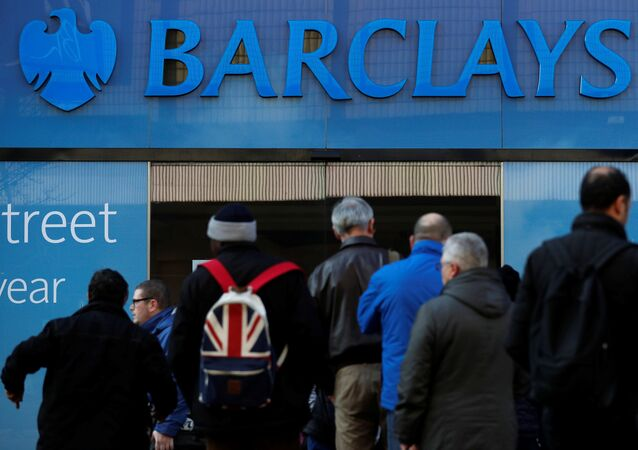 Customers queue outside a branch of Barclays bank in Manchester northern England, March 17, 2016