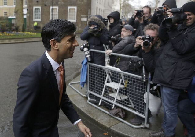 British lawmaker Rishi Sunak, and Chancellor of the Exchequer leaves 10 Downing Street, where he was given the job by Britain's Prime Minister Boris Johnson, as the former Chancellor Sajid Javid, resigned, in London, Thursday, Feb. 13, 2020