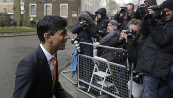 British lawmaker Rishi Sunak, and Chancellor of the Exchequer leaves 10 Downing Street, where he was given the job by Britain's Prime Minister Boris Johnson, as the former Chancellor Sajid Javid, resigned, in London, Thursday, Feb. 13, 2020 - Sputnik International