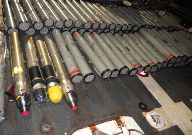 "The crew of the guided-missile cruiser USS Normandy (CG 60), in accordance with international law, seized an illicit shipment of advanced weapons and weapon components, which held 358 surface-to-air missile components and ""Dehlavieh"" anti-tank guided missiles (ATGM), intended for the Houthis in Yemen, aboard a stateless dhow during a maritime interdiction operation in the U.S. Fifth Fleet area of operations, Feb. 9, 2020."