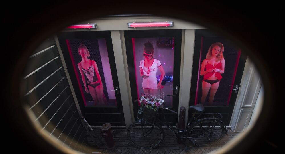 Three video's of women posing as sex workers are projected behind three doors at the Red Light Secrets Museum of Prostitution in Amsterdam