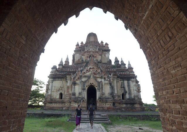 Foreign tourists visit Myanmar's old temple in Bagan, Nyaung U district, central Myanmar, Sunday, June 24, 2018.