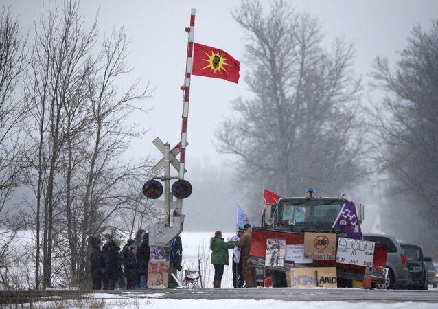 First Nations members of the Tyendinaga Mohawk Territory block train tracks servicing Via Rail